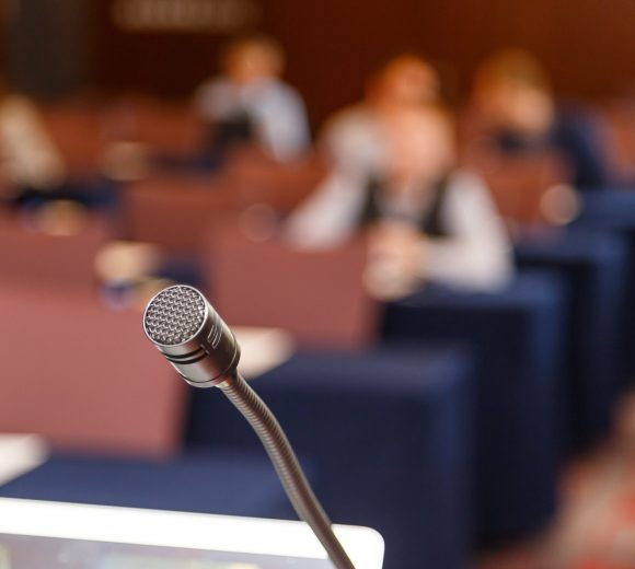 Microphone over conference hall background, Business meeting concept.